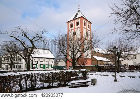 Odenthal, Germany - January 24, 2021: Center Of Village Odenthal With Parish Church And Old Building