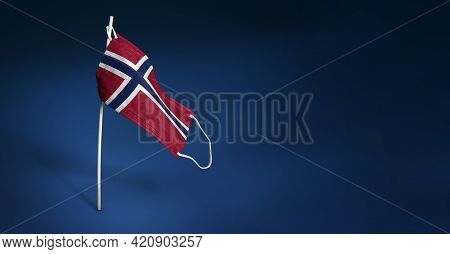 Norway Mask On Dark Blue Background. Waving Flag Of Norway Painted On Medical Mask On Pole. Concept
