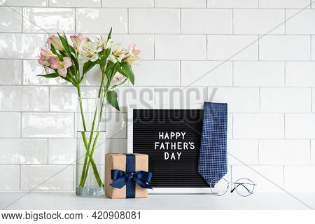 Happy Fathers Day Concept. Festive Composition With Gift Box Wrapped Craft Paper With Blue Ribbon, L