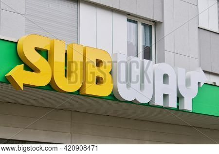 Wohlen, Aargau, Switzerland - 18th April 2021 : Subway Store Sign Hanging In Front Of A Shop In Wohl