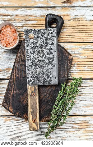 Old Meat Butcher Cleaver. White Wooden Background. Top View