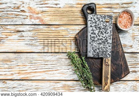 Old Meat Butcher Cleaver. White Wooden Background. Top View. Copy Space