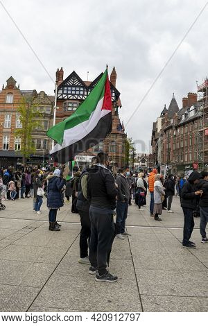 Nottingham, Nottinghamshire - May 15, 2021. Man Holding A Palestine Flag In The Old Market Square At