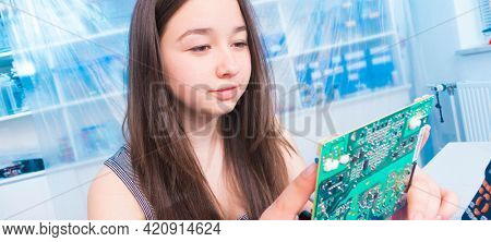 Young woman create  digital electronic project with  circuit board PCB in laboratory
