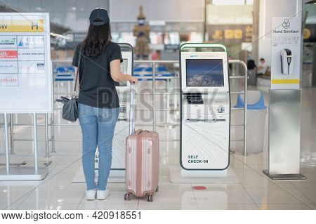 Bangkok Thailand Apr 14 2021  Female Hand Using The Auto Self Service Check-in For Get The Boarding