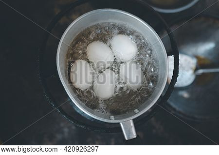 Boiled Duck Eggs In A Pot Of Boiling Water. Top View