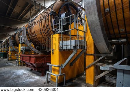 Leather Workshop. Large Wooden Barrels For The Tanning Of Cattle Leather. The Barrels Are Tied With
