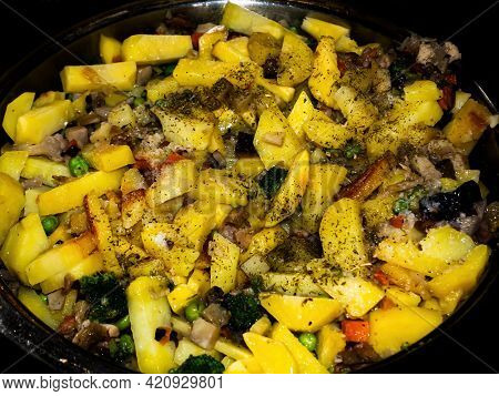 Fried Potatoes With Vegetables In A Pan. Cooking Vegetables. Fry Potatoes. Frying Pan Kitchen Utensi