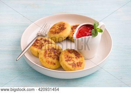 Vegan Tofu Vanilla Syrniki, Cheesecakes With Strawberry Sauce On A Light Blue Background. Delicious
