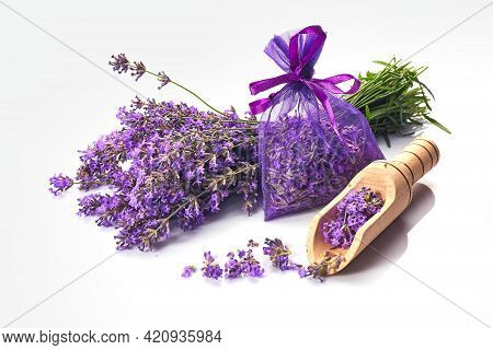 Fragrant Bag Or Pouch With Lavender Flowers On White Background. Sprigs Of Lavender Near The Sachet