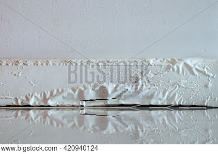 White Skirting Board Damaged By Destructive Elements From Moisture Or Water.