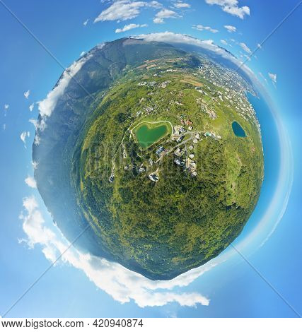 Little planet panorama of Yalta town and magabi lake in form of herat. Spring mountain forest, and sea shore.