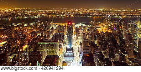 High View Over Manhattan West And Pennsylvania Station At Night, Over Hudson River Towards Jersey Ci