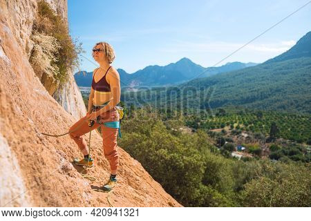 Woman Stands On A Large Rock And Belays The Climber, Climbing In Turkey, Partner Belaying, Belay Dev