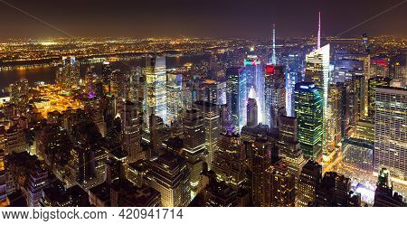 High View Over Midtown West Manhattan Towards Hudson River At Night, New York City.