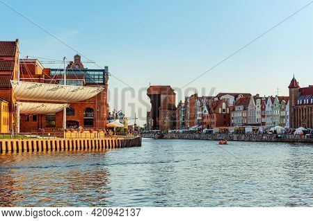 Gdansk Beautiful Old Town Cityscape, View On Traditional And Modern Architecture And Motlawa Riversi