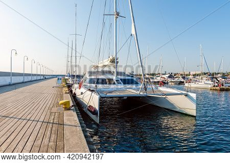 Sailing Yachts Moored On A Pier In A Harbour On Baltic Sea In A Sunny Morning. Nautical Vessel For C