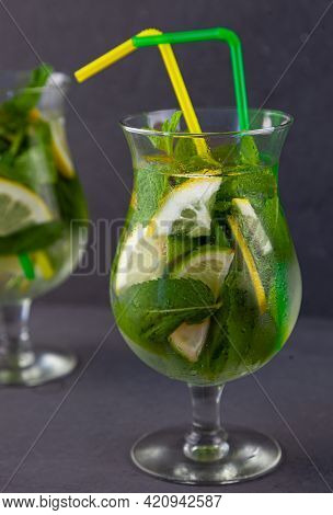 Summer Mint Lime Refreshing Cocktail Mojito With Rum And Ice In Glass On Gray Background. Mojito Coc