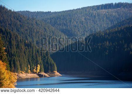 Mountain Lake In Autumn Season. Beautiful Countryside Scenery On A Sunny Morning. Bright Blue Sky Wi
