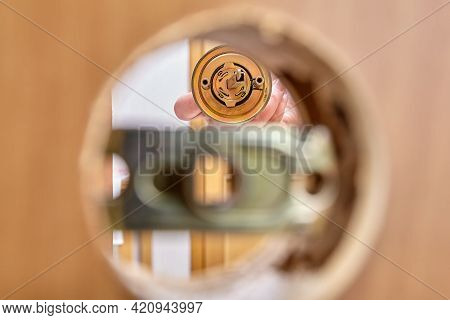 Assembling Door Lock With Knob And Latch, Inserting Bolt Into Assembly Mechanism.