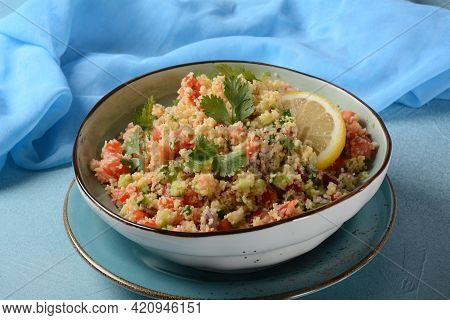 Tabbouleh - A Middle Eastern Cuisine Vegetarian Salad With Chopped Parsley, Tomatoes, Mint, Onion An