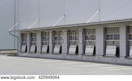 Transportation Depot With A Lot Of Doors For Loading The Cargo Into The Truck Vehicles