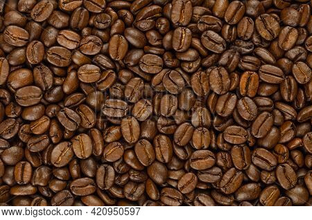Roasted Coffee Beans, Background, From Above. Dark Brown, Roasted Seeds Of Berries From Coffea Arabi