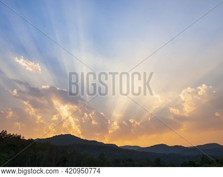 Clouds And Sunbeam Over The Mountain In Evening.