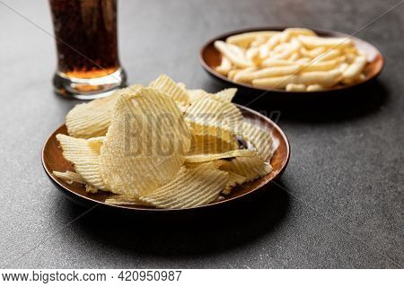 Potato Chips, French Fries Snack And A Glass Of Cola. Food And Drink Concept.