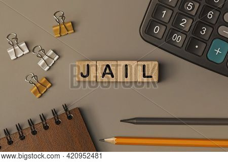 Word - Jail - On Small Wooden Blocks On The Desk. Conceptual Photo. Top View