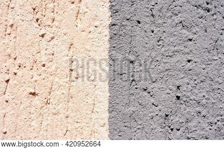 Gray With Pink Painted Exterior Wall Textured Background. Exterior Plastered Wall Of Exposed Buildin