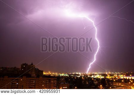 Lightning Strike The Ground In The City At Night.