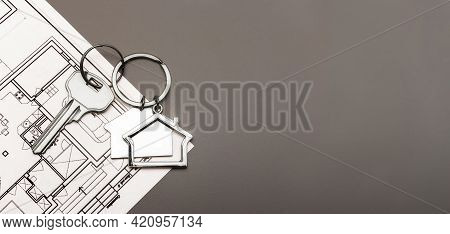 The Concept Of Mortgage And Rental Housing And Real Estate. Mortgage Credit Lending. Metal Keychain