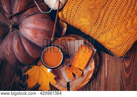 Top View Of Autumn Composition With A Cup, A Pumpkin, Pie And A Sweater. Pumpkin Juice And Sweet Fre