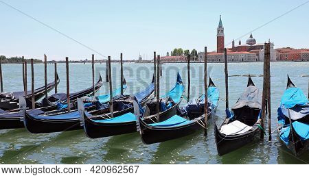 Gondolas Typical Venetian Boats Moored In The Giudecca Canal In Front Of The Old Church Of San Giorg