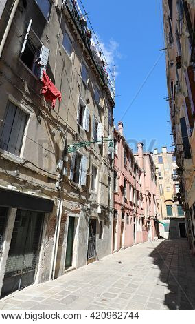 Glimpse Of The City Of Venice In Italy With The Narrow Alley That In Venetian Italian Is Called Call