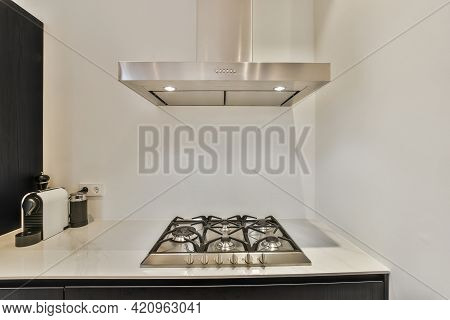 Contemporary Built In Gas Cooktop And Stainless Hood In Minimalist Style Kitchen Of Modern Apartment