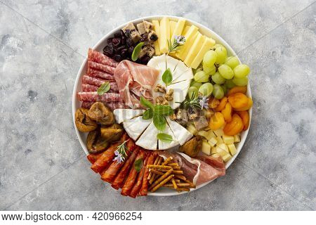 Charcuterie Assortment, Variety Of Cheeses And Salami, Prosciutto And Dried Fruits, Figs, Apricots,