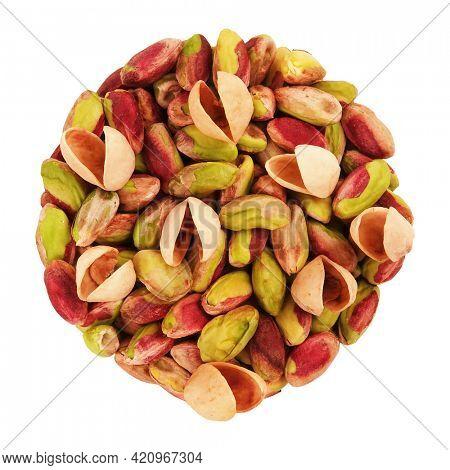 Pistachios peeled kernels and shells round pile isolated on white background