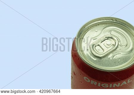 Warsaw, Poland - April 26, 2021: Coca-cola Can On A Blue Background. Copy Space For Text. Water Drop