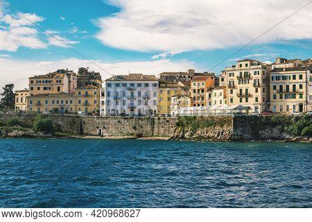 Corfu Island/greece- May 7, 2019: Kerkyra Cityscape - Sea Bay With Calm Turquoise Water, Colorful Ol