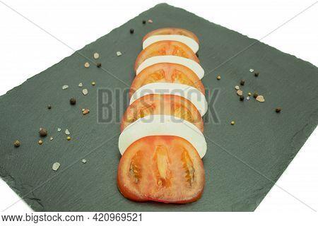 Fresh Tomato And Mozzarella Cheese On A Stone Board. Caprese Salad. Mozzarella Cheese With Tomatoes