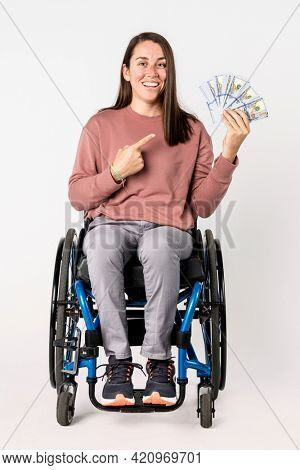 Cool woman in a wheelchair with disability allowance