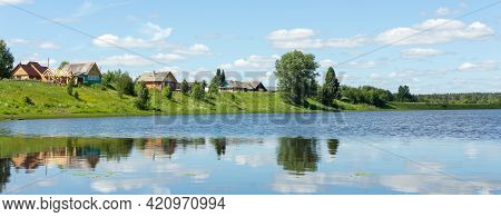 Typical Russian Landscape. Russian Village On The Shore Of The Lake. Panoramic Photo - Image
