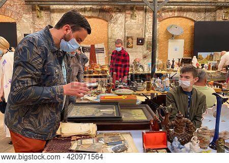 Lviv, Ukraine - May 16, 2021 : People Wearing Face Masks Shopping On Garage Sale In Lem Station, Tlu