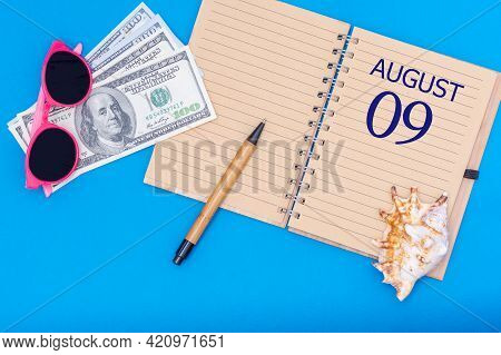 9th Day Of August. Travel Concept Flat Lay - Notepad With The Date Of 9 August Pen, Glasses, Dollars