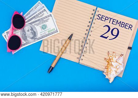 29th Day Of September. Travel Concept Flat Lay - Notepad With The Date Of 29 September Pen, Glasses,