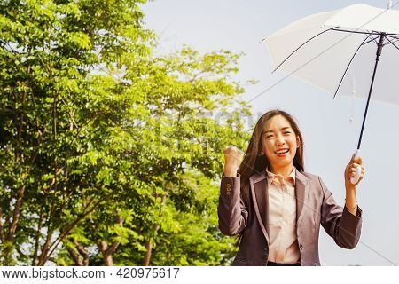 World Environment Day Concept : Asian Business Women Enjoy The Environment, Green Trees And Clean Ai