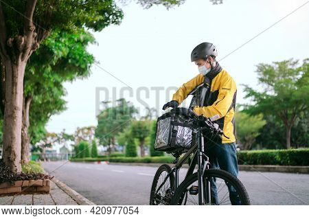 Delivery Asian Man Removing His Backpack Moning