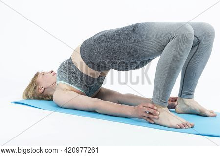 Mature People Sport Concepts. Natural Portrait Of Mature Caucasian Woman Practicing Yoga Asana Pose